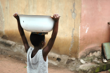 Child carries water