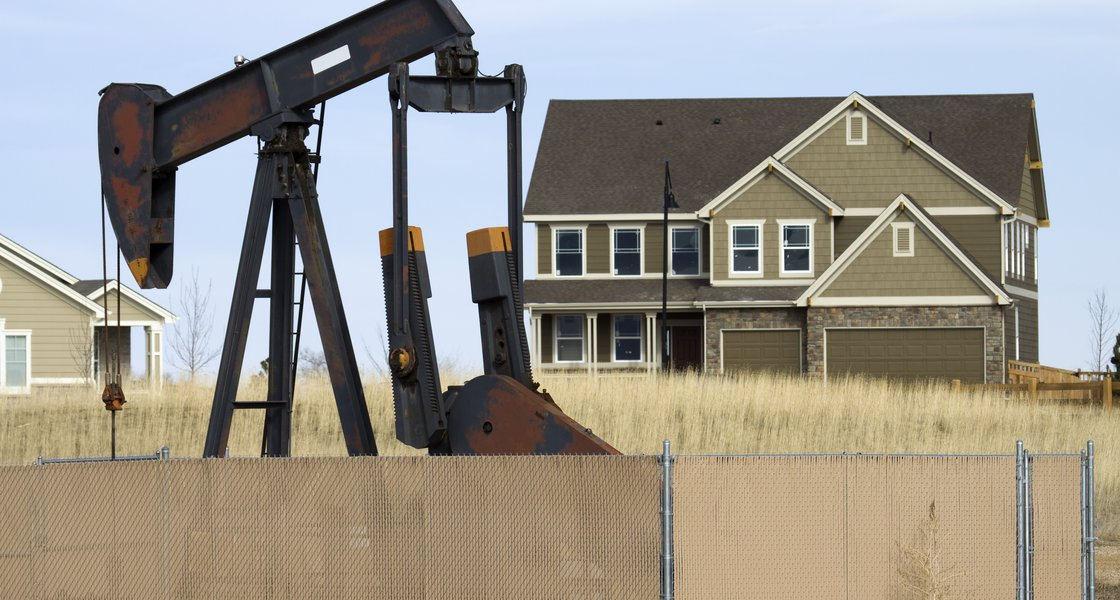 Pump jack / oil rig near house