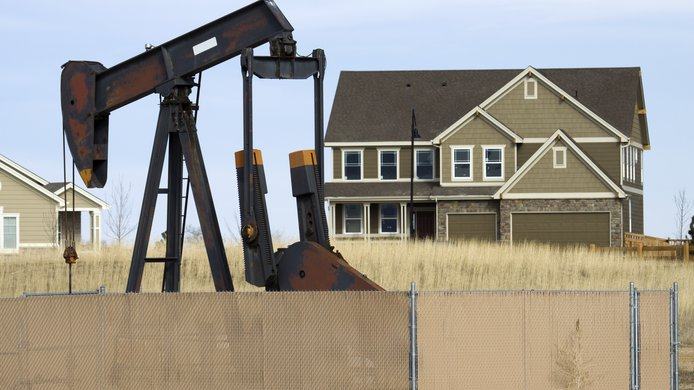 Pump jack / oil rig near house