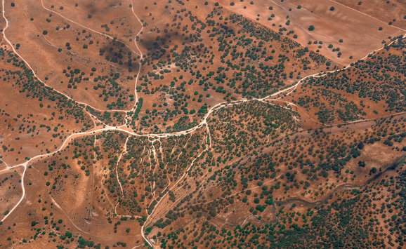 Abstract aerial landscape with dusty roads like rivers