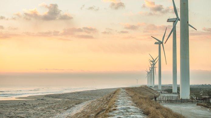 Windmills by ocean sunset.jpg