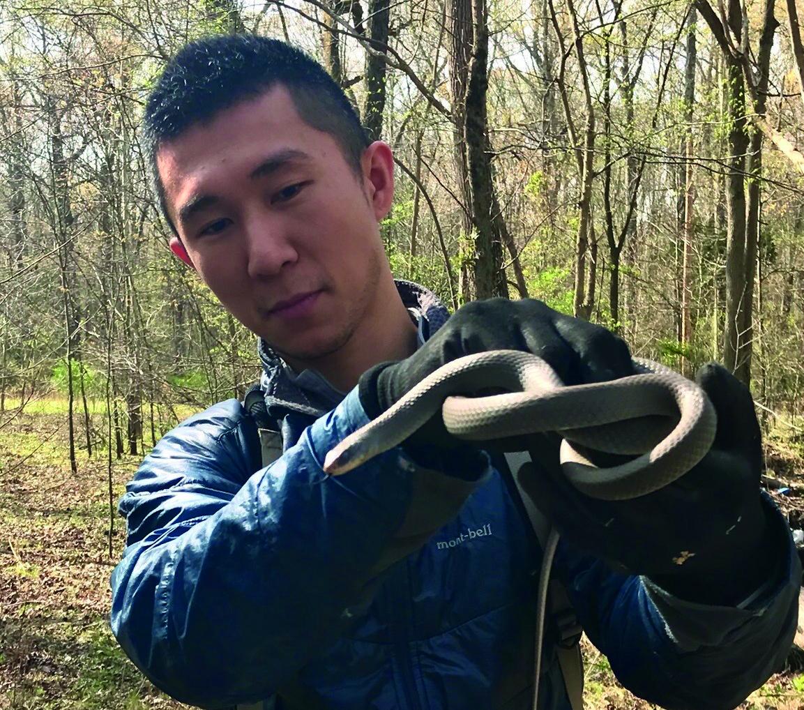 Ya-Wei (Jake) Li with snake