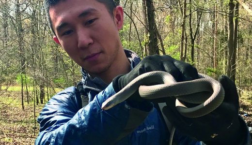 Ya-Wei (Jake) Li with snake